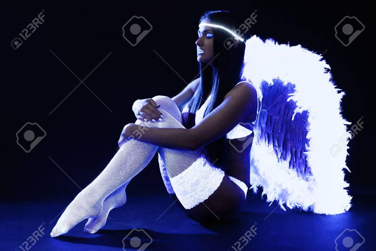 Full length portrait of pretty go-go girl in angel costume - 17280866