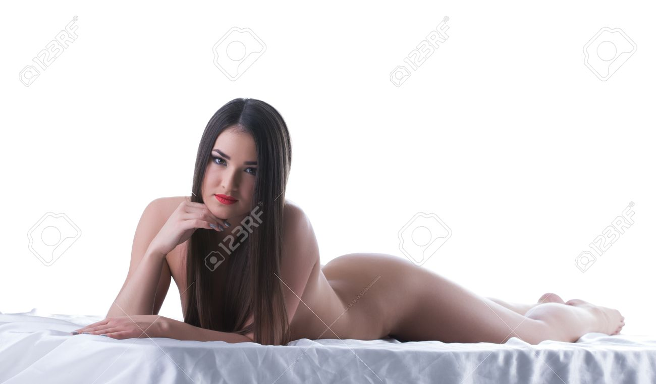 beauty woman with long hair lying naked on bed isolated on white