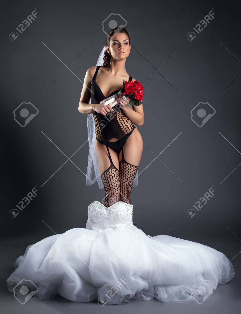 83437e77c Proud bride posing in erotic lingerie, on gray background Stock Photo -  19730897
