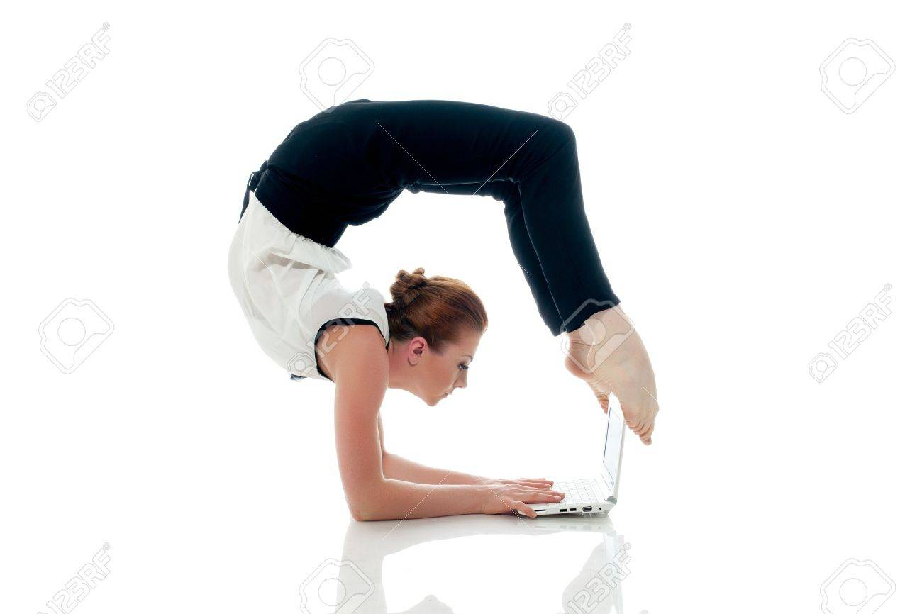 Businesswoman doing yoga and typing on netbook, isolated on white - 26436157