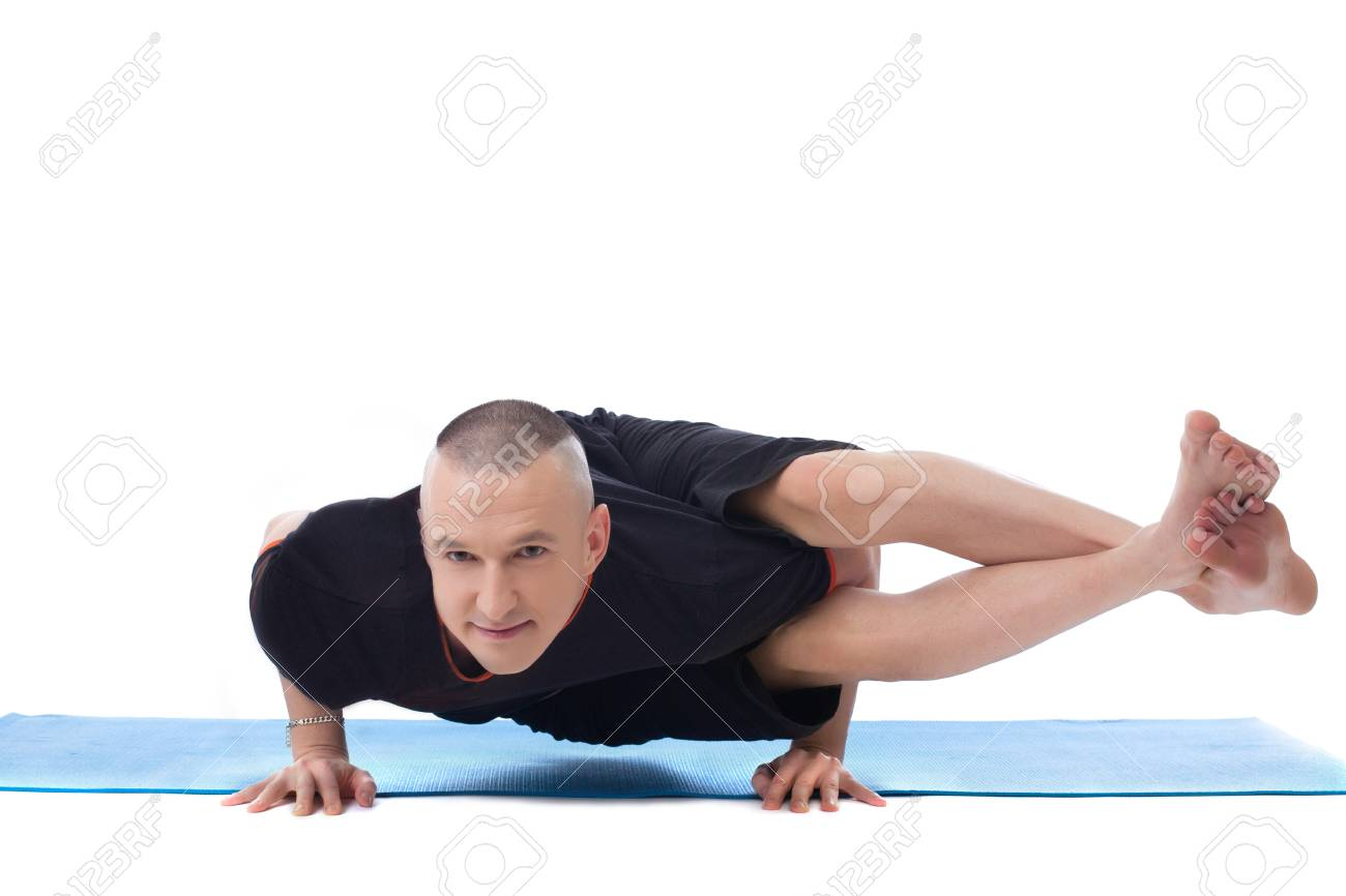 Smiling Flexible Man Posing In Difficult Yoga Pose Isolated On White Stock Photo