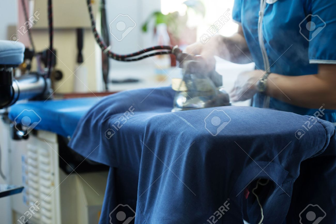 Image of laundry worker at work, close-up - 31310746