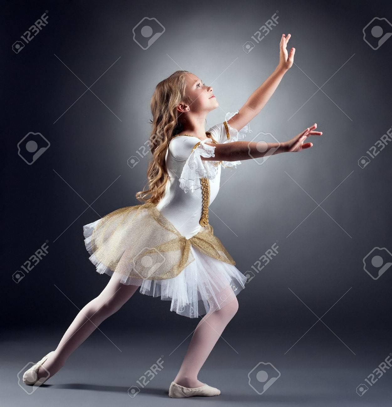 Image of lovely little ballerina dancing at camera - 33926427