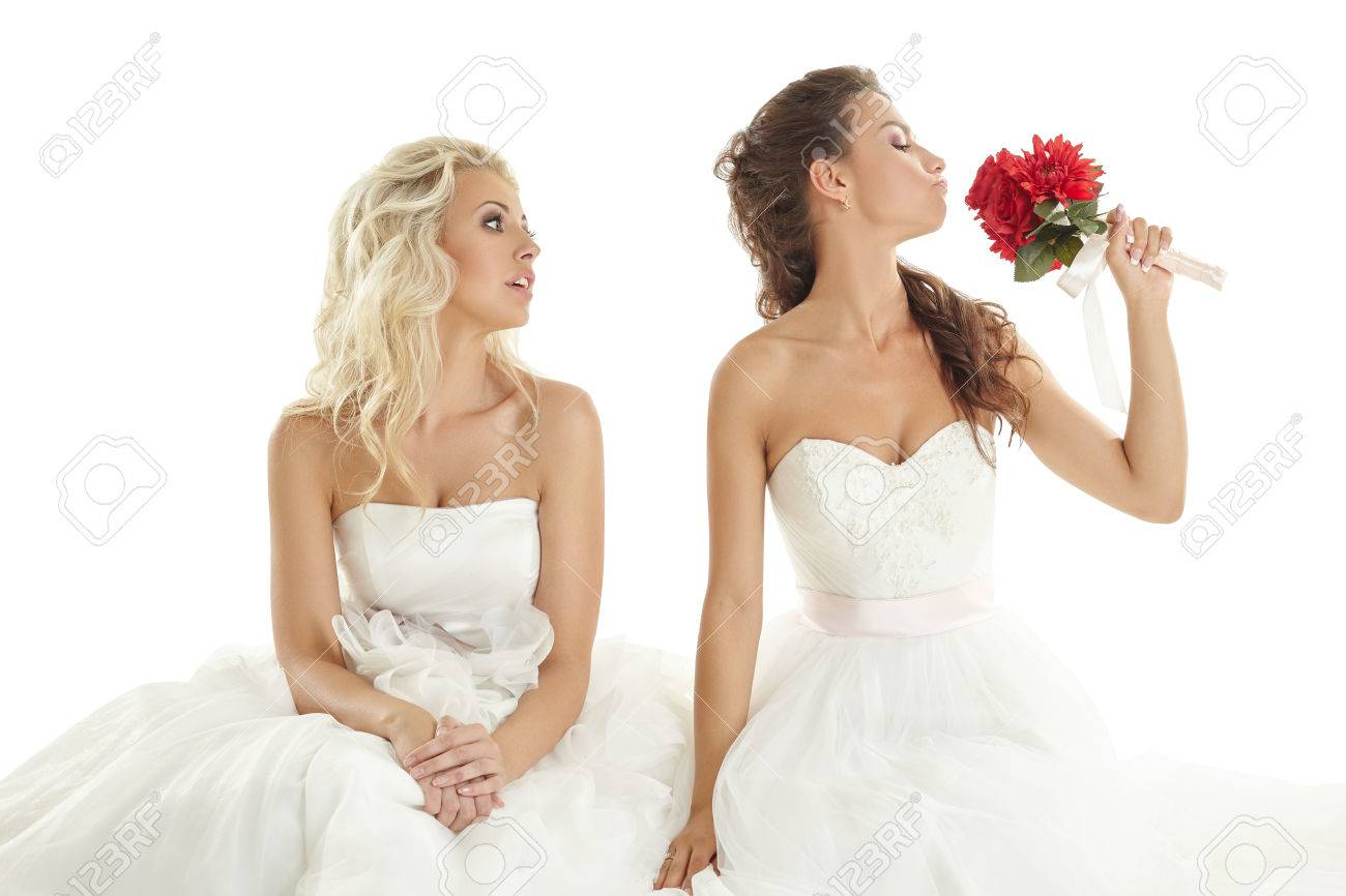 Concept of double wedding two pretty brides posing in studio banco concept of double wedding two pretty brides posing in studio imagens 36685794 junglespirit Gallery