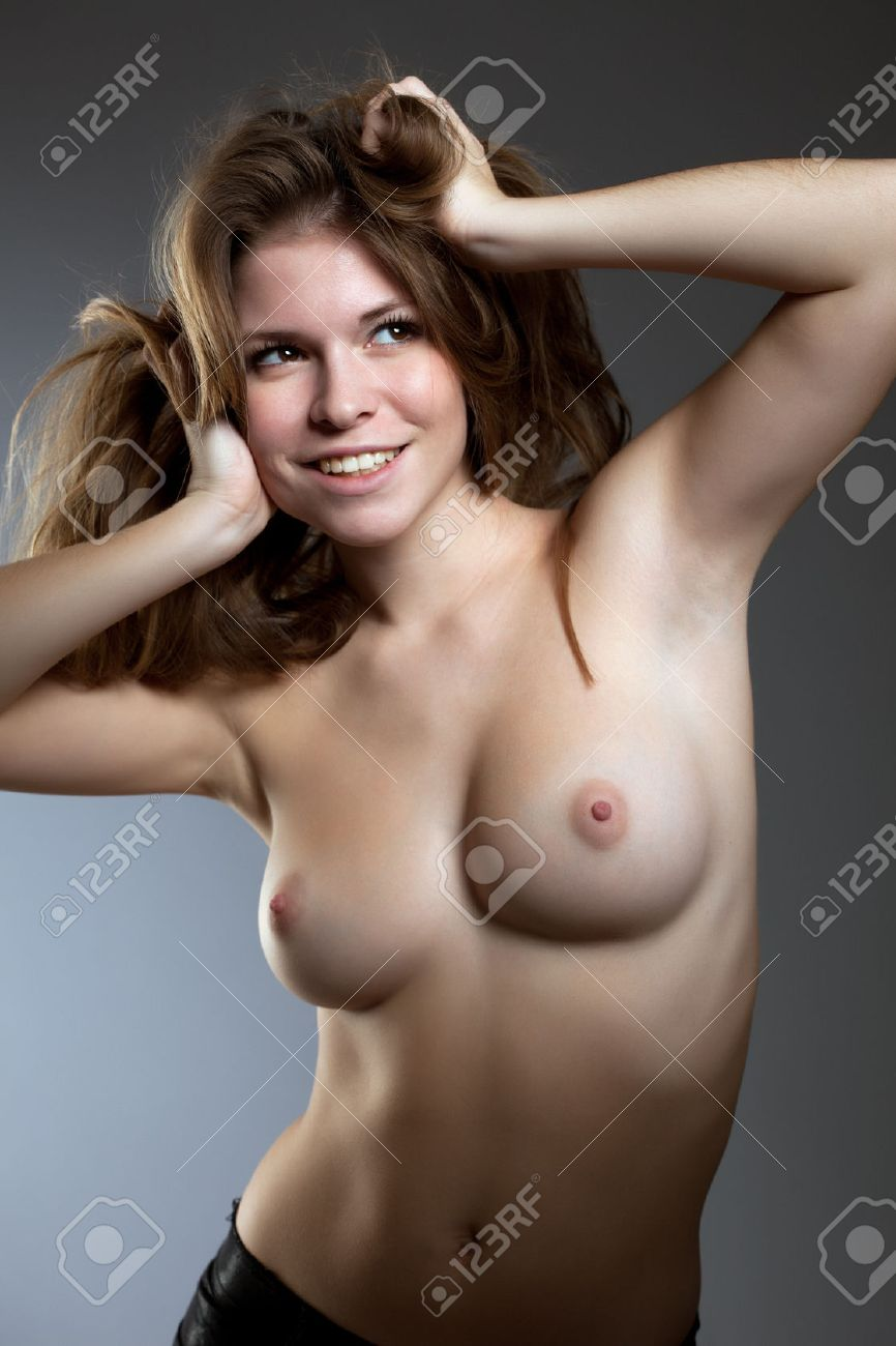 cute smiling girl posing with naked breasts, close-up stock photo