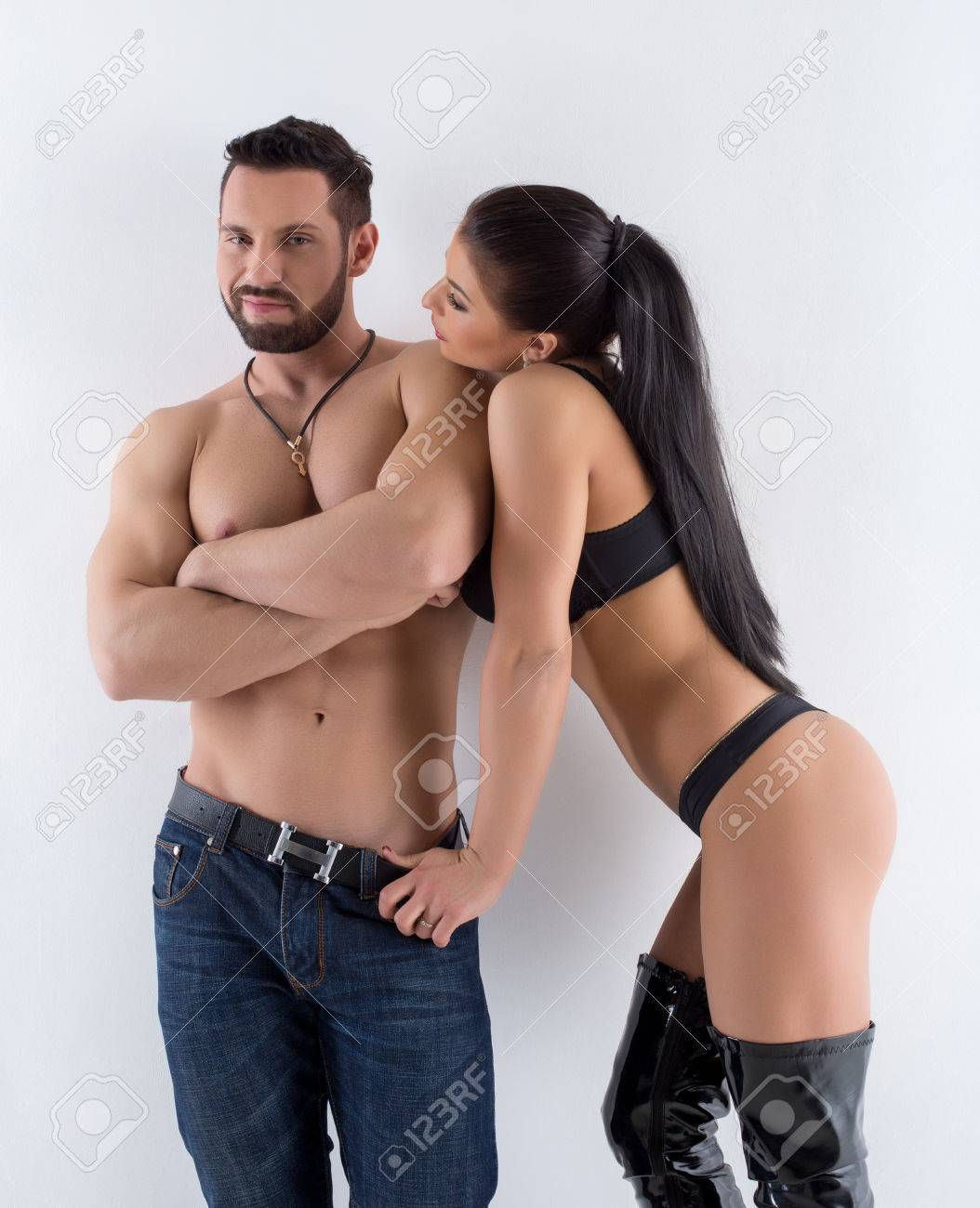 Hot Brunette Flirts With Sexy Muscular Man At Camera Stock Photo Picture And Royalty Free Image Image 38252114