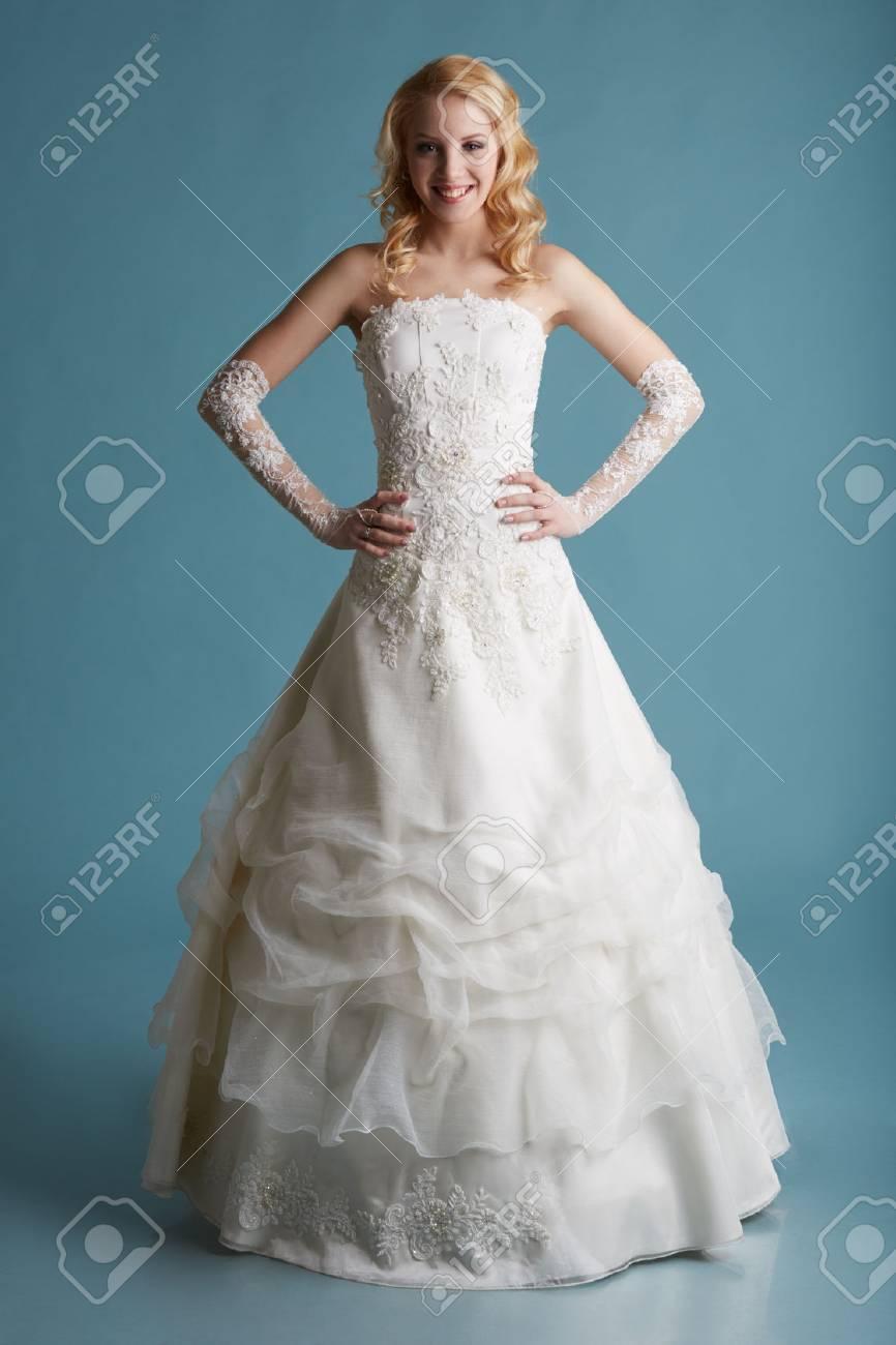 Image Of Smiling Model Touts Elegant Wedding Dress, On Blue ...