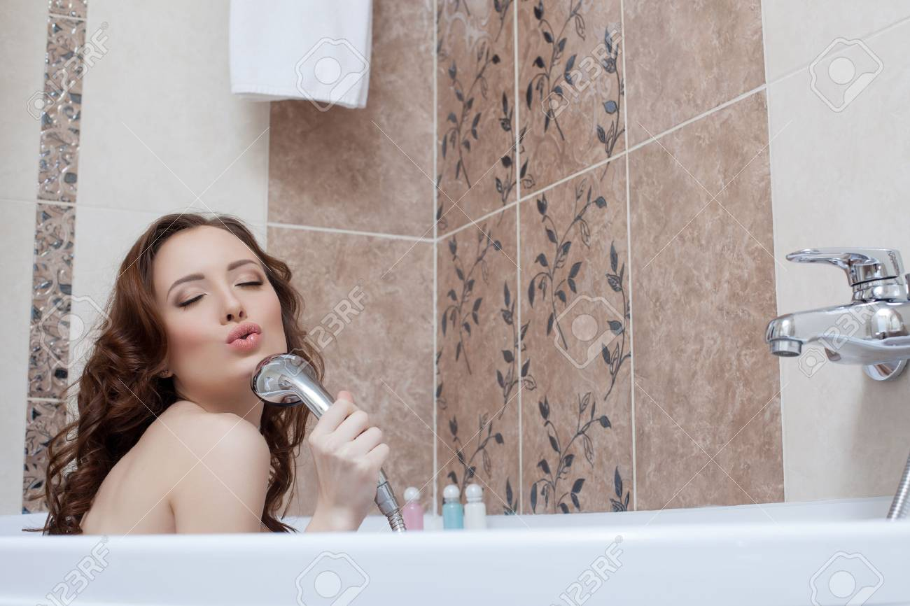 Pretty Woman Fooling Around While Singing In Bathroom Stock Photo