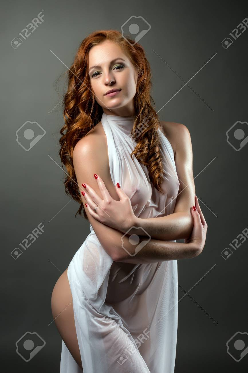 Image of woman posing in wet dress on her body - 43423195