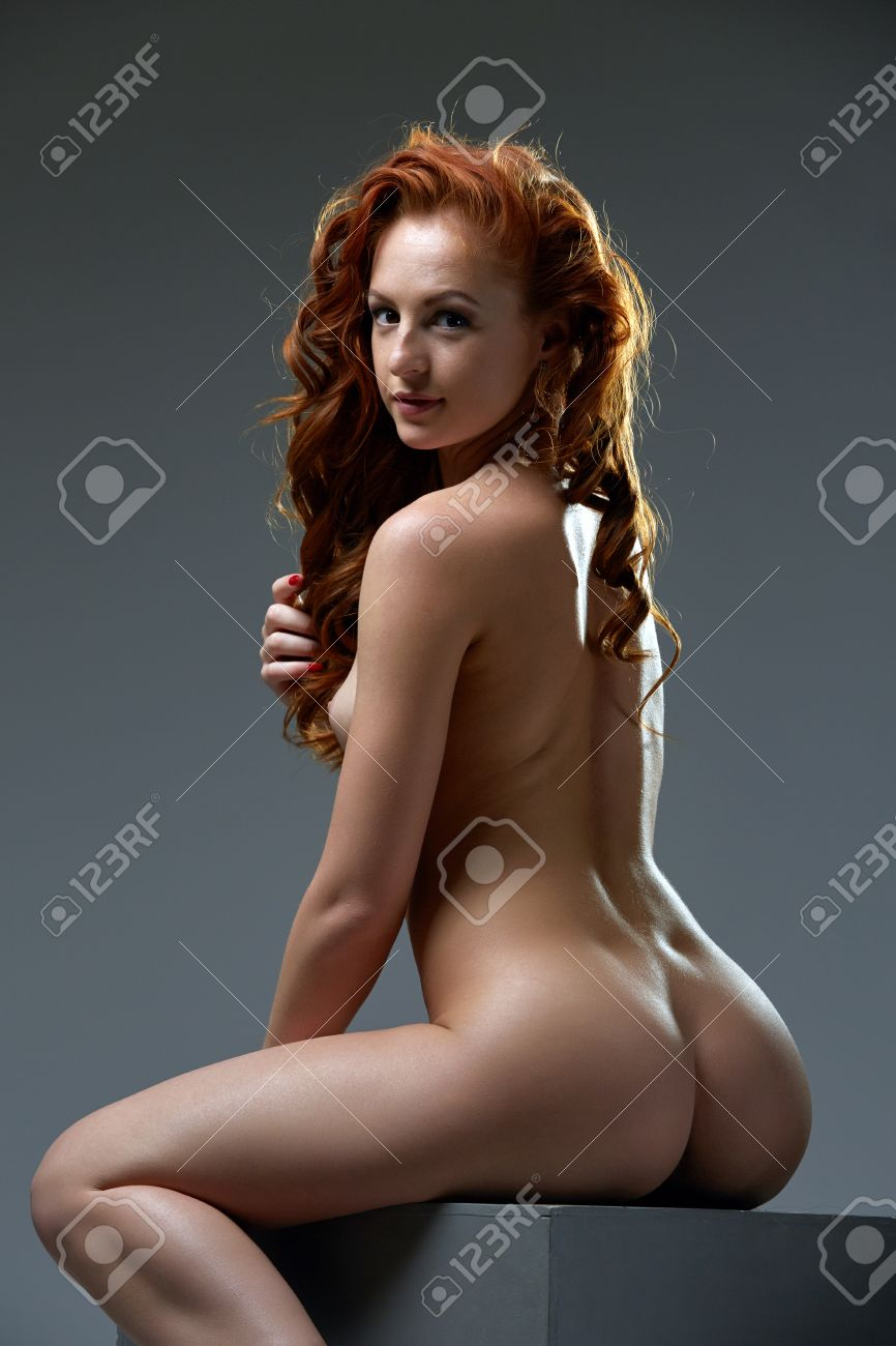 Image Of Curly Red Haired Beauty Posing Nude At Camera