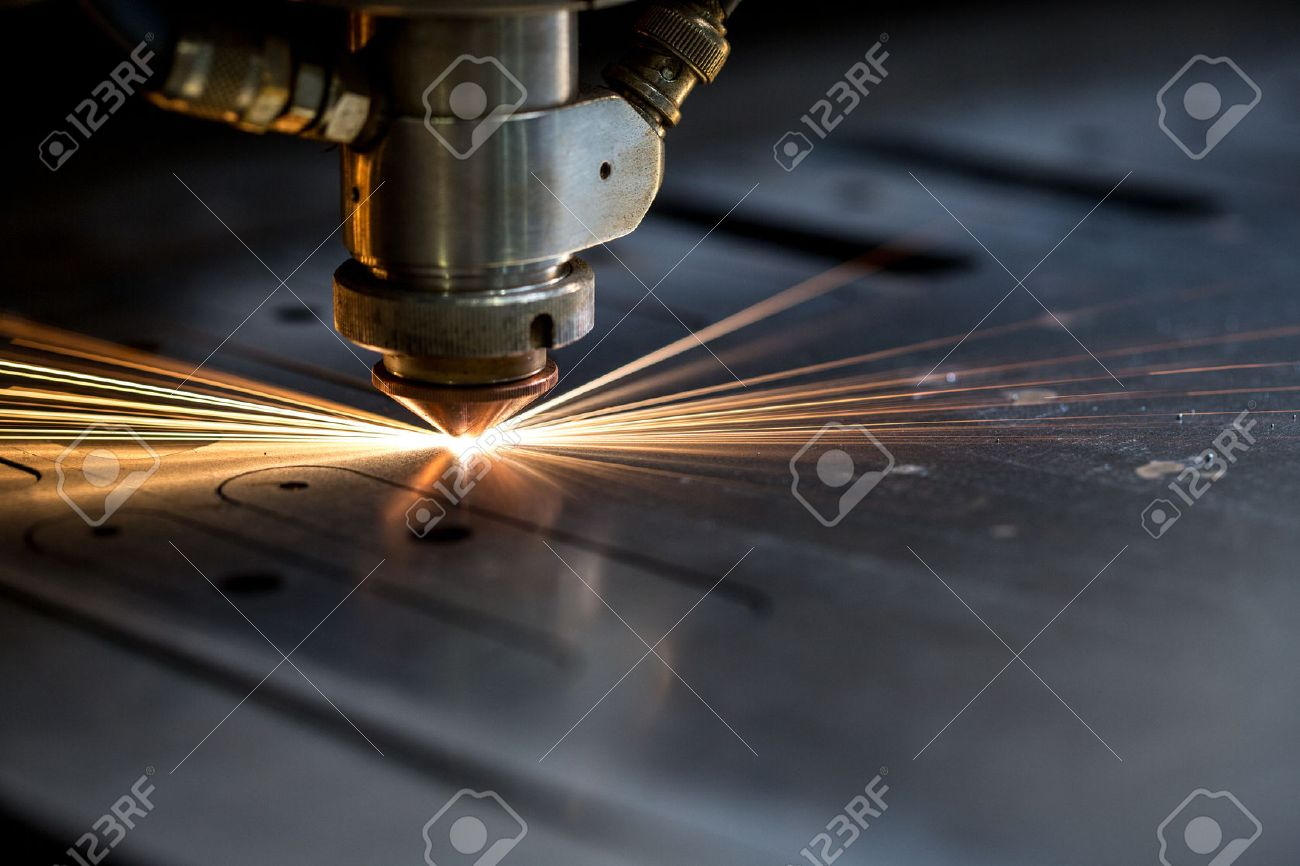 Cutting of metal. Sparks fly from laser, close-up - 45244314