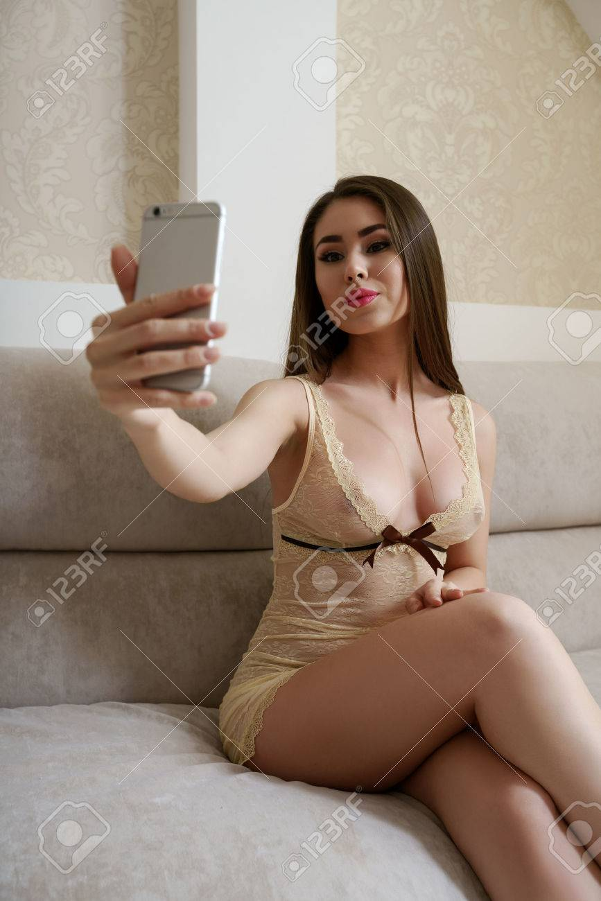 Hotel Erotica image of beautiful model doing erotic selfie in hotel room