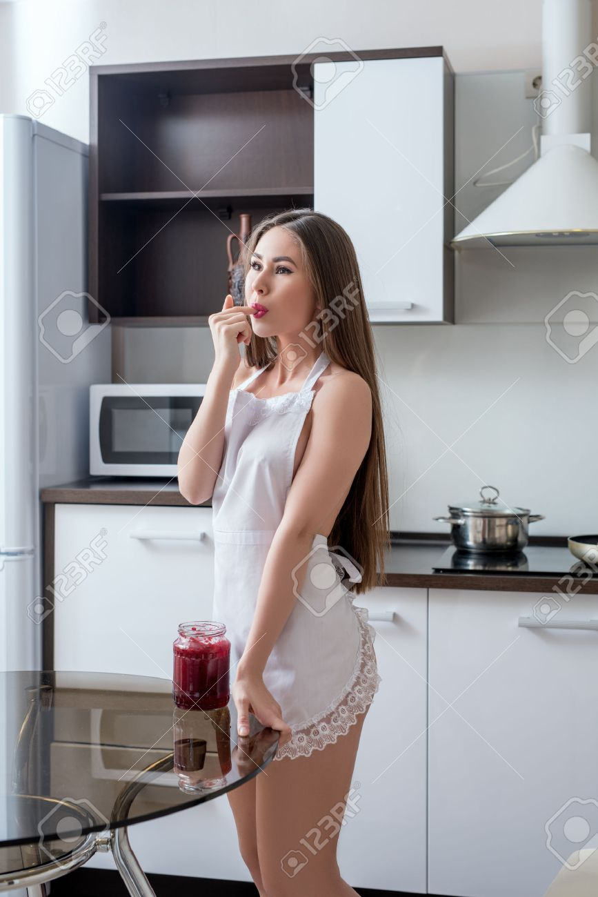 Hot girls in apron Kitchen Pleased Girl In Apron Tasting Jam Stock Photo Picture And Royalty Free Image Image 50803301