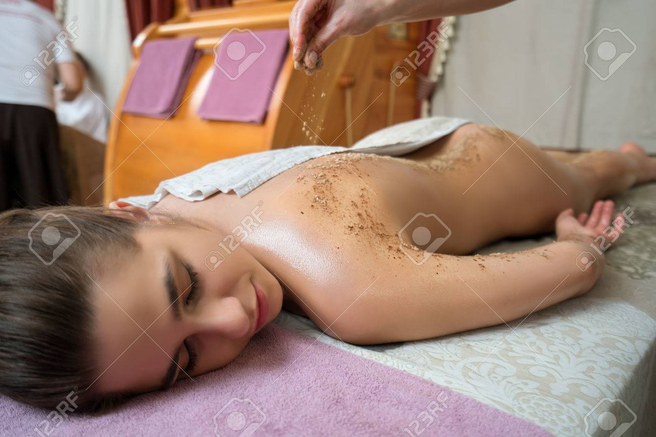spa massage. image of young girl lying on her stomach stock photo