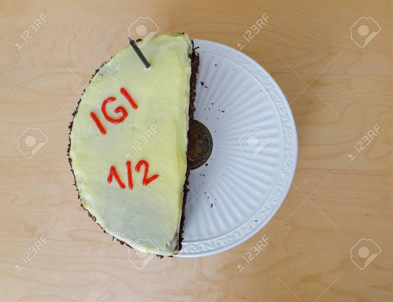 Fabulous Half Birthday Cake With One Candle For Half Year Birthday Stock Personalised Birthday Cards Veneteletsinfo
