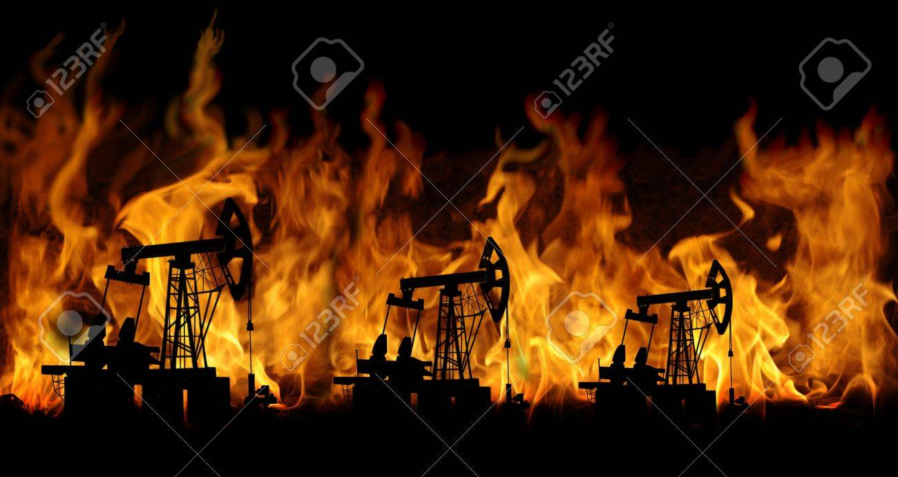 oil pumps on fire background - 8619320