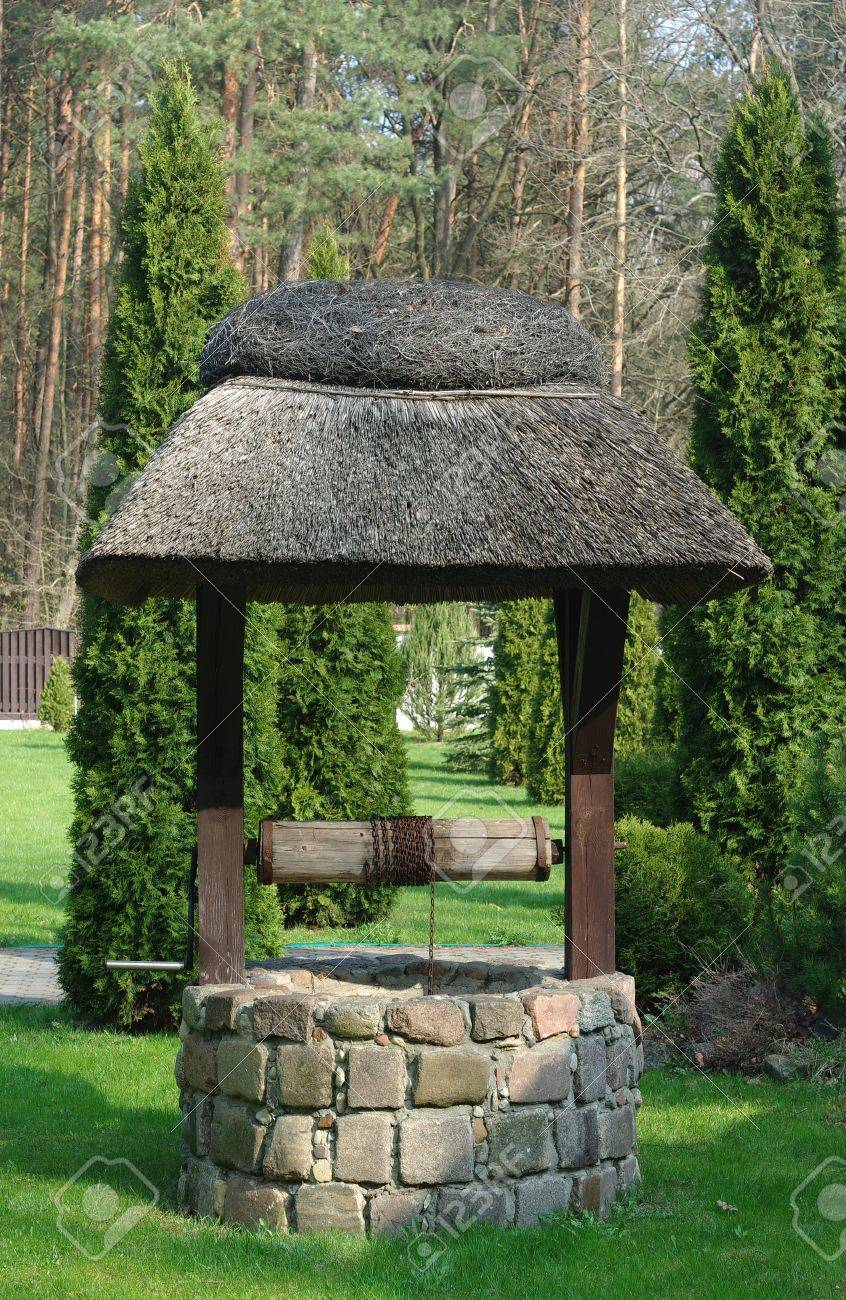 old well on a forest background - 9419398