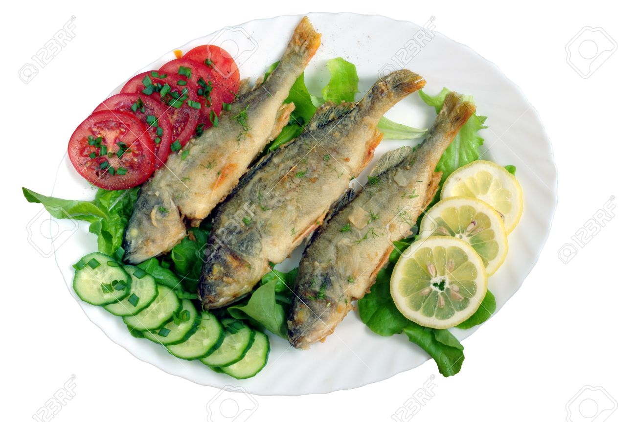 fried fish with vegetables on white plate - 9694349