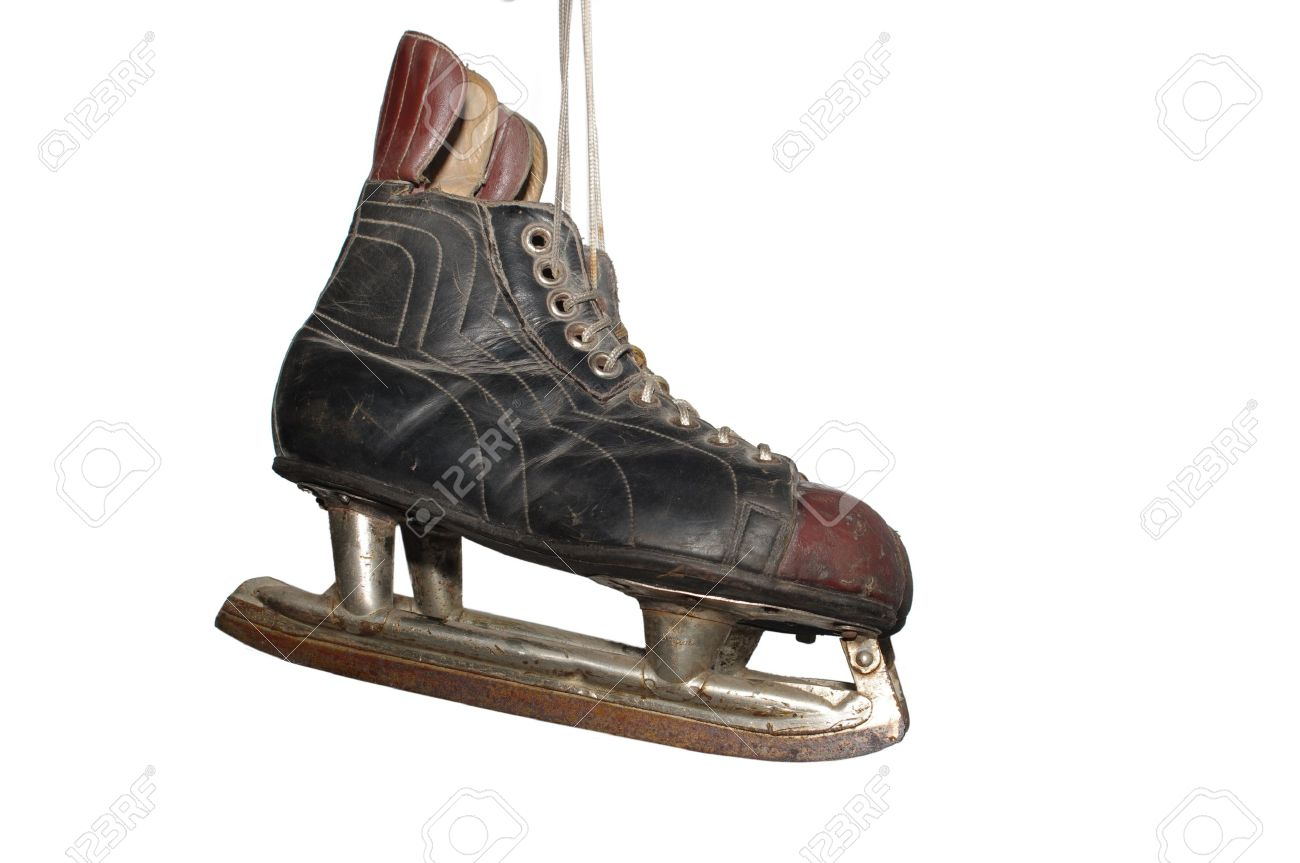 old hockey skates on white background stock photo picture and