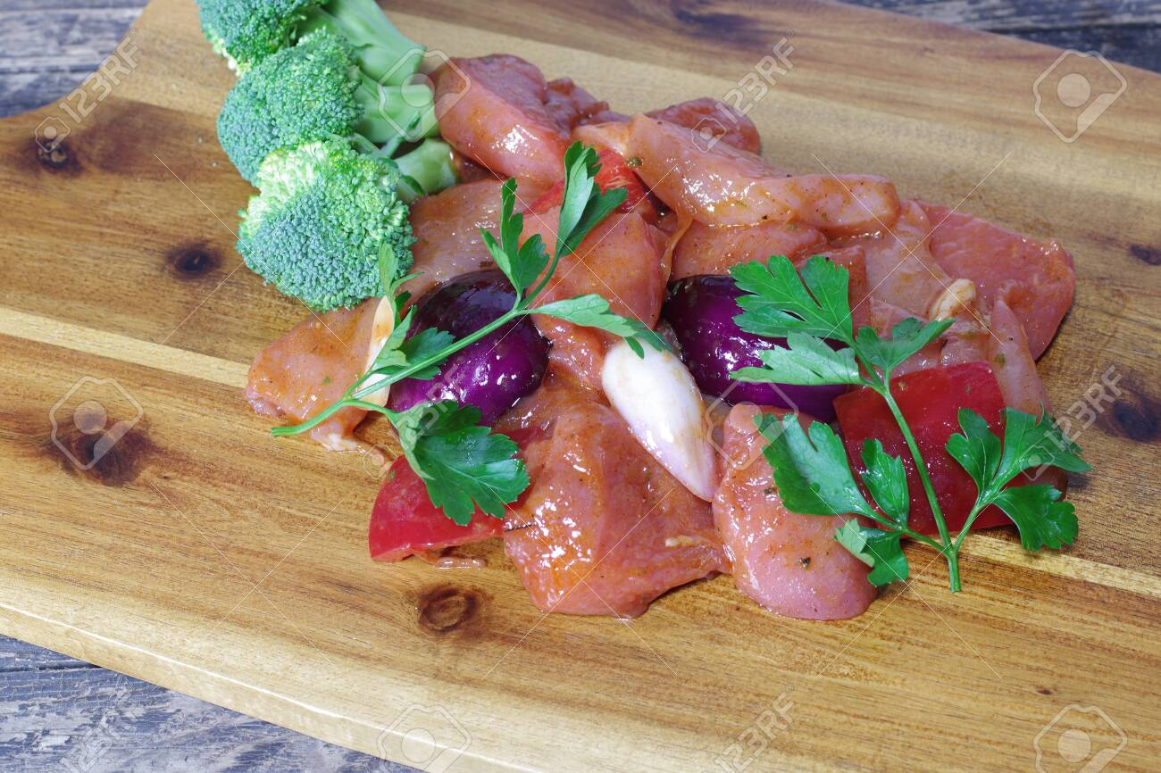 chicken meat with vegetables on wooden board - 143402457