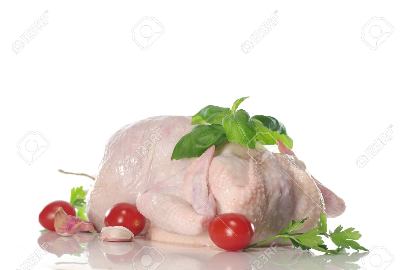 raw chicken with parsley on black plate - 143402460