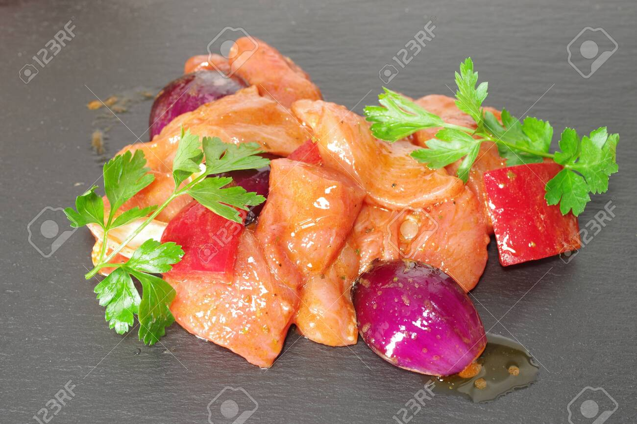 chicken meat with vegetables on stone background - 143402463