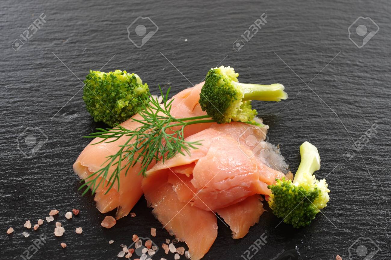 slices of smoked salmon with dill black plate background - 143402373