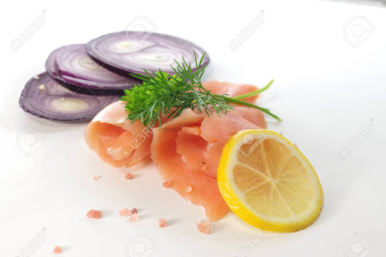 slices of smoked salmon with dill on white background - 143401481