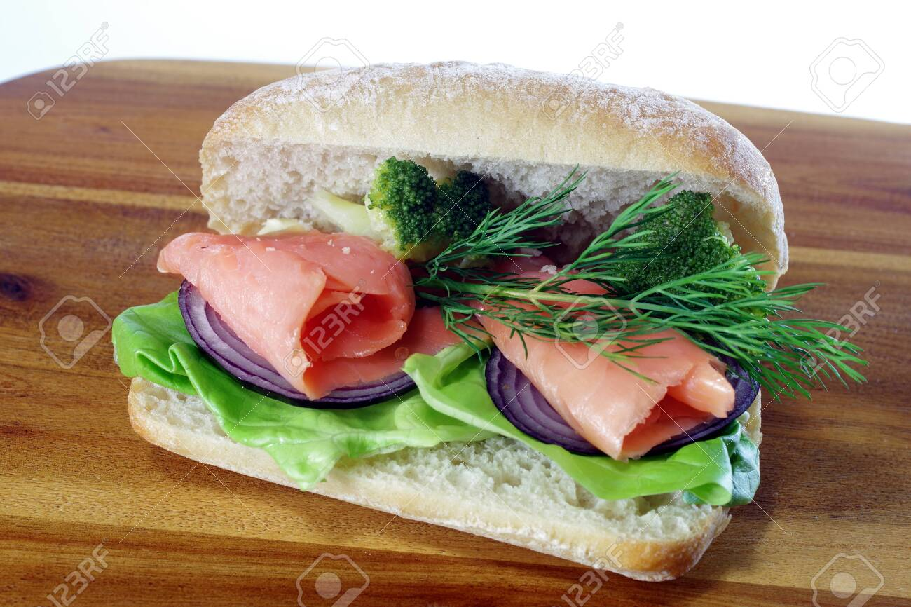 sandwich with smoked salmon on board background - 142680542