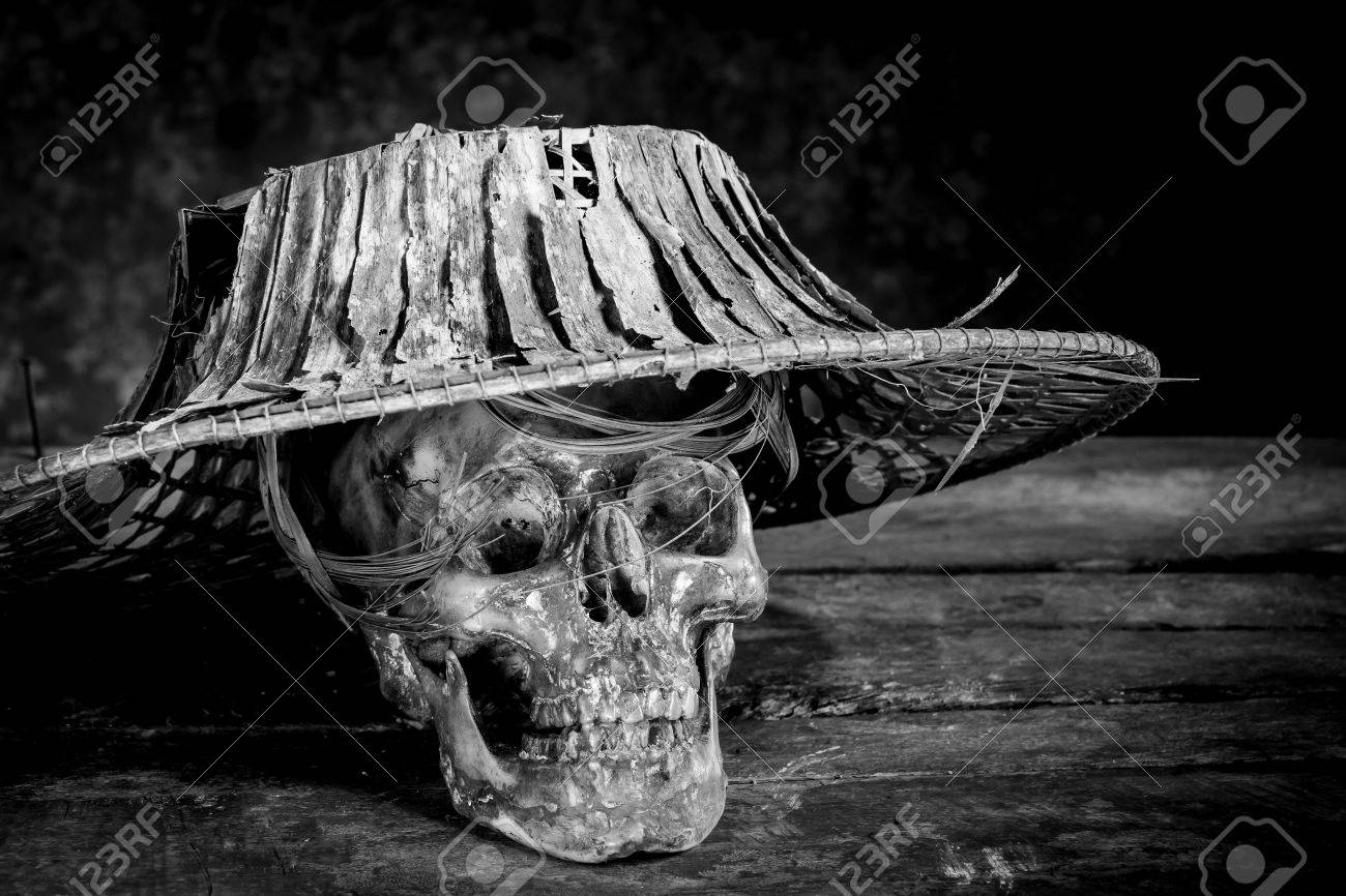 Still life black and white photography with human skulls on wood table stock photo 62190657