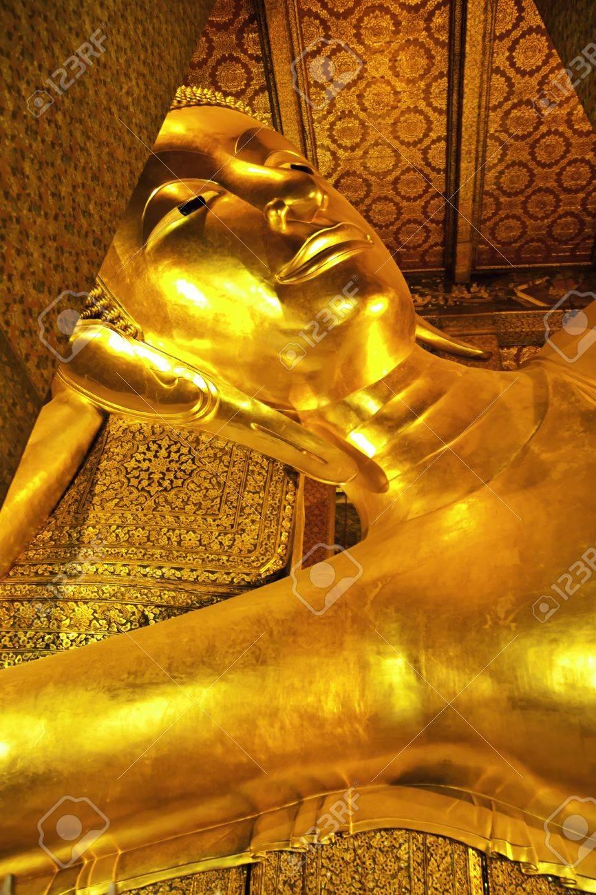 The beautiful reclining golden Buddha at Wat Pho of Bangkok Thailand. Stock Photo - 11487723