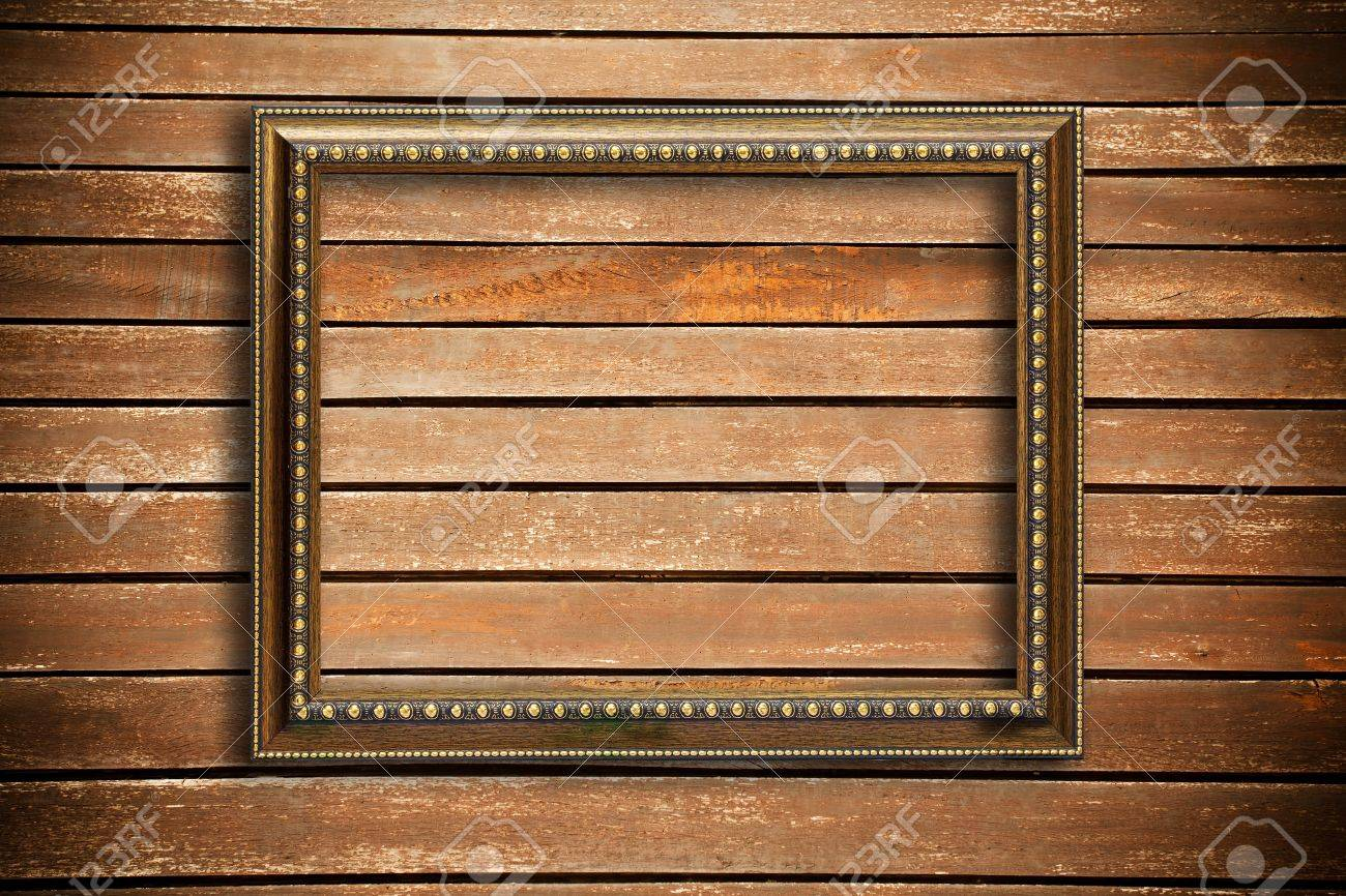 Photo frame on wood wall background Stock Photo - 9443318