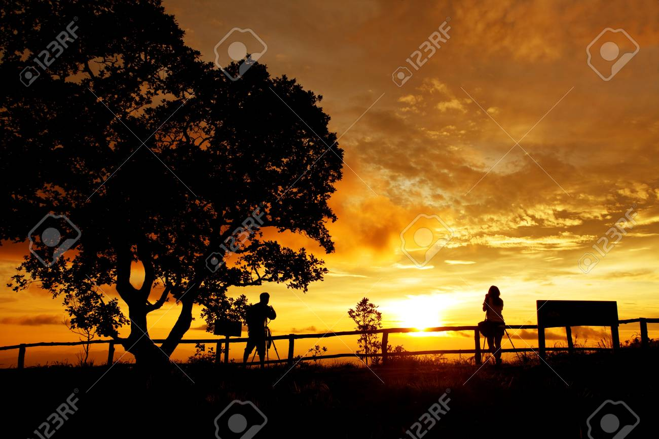 silhouette of photographers on the Mountain Stock Photo - 9659206