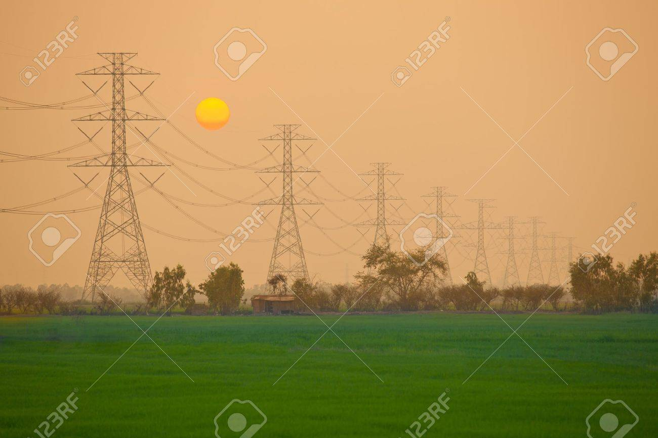 Electric power station in the field on sunset Stock Photo - 12624217