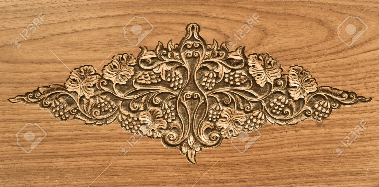 Pattern of flower carved on wood background Stock Photo - 13643177