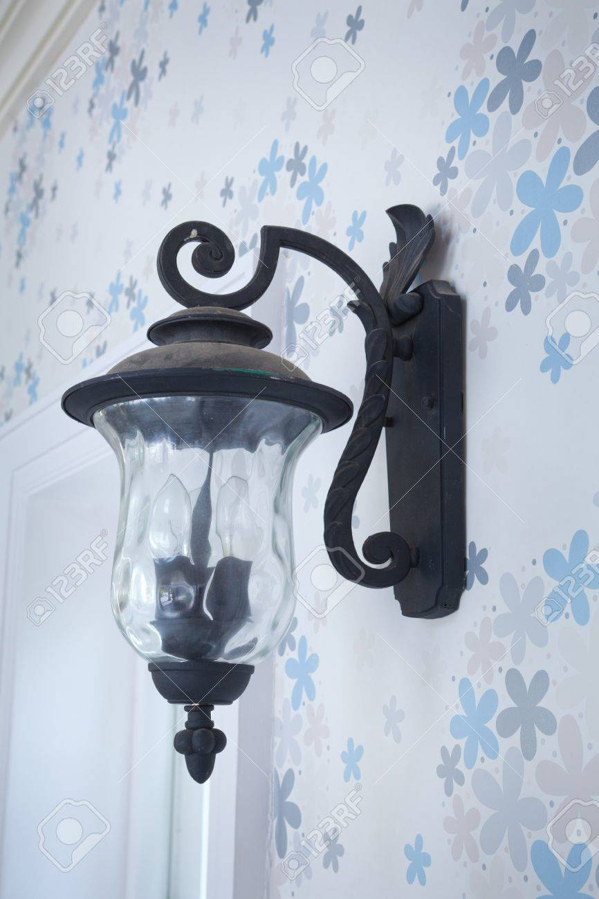 vintage wall lamp on blue wood wall Stock Photo - 14849184