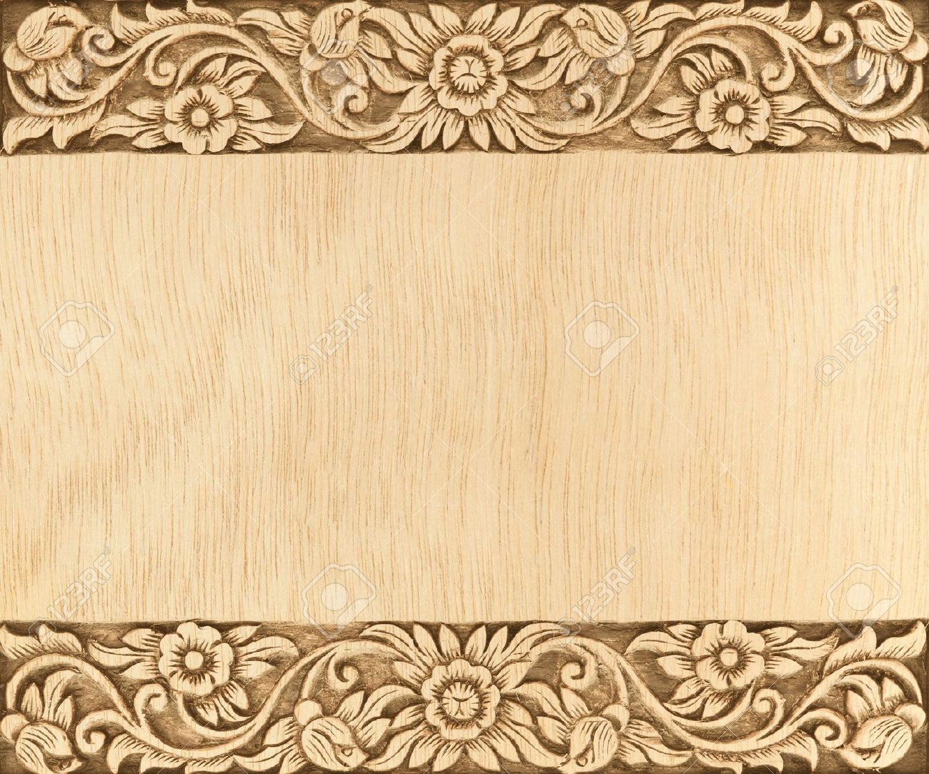 Pattern Of Flower Carved Frame On Wood Background Stock Photo