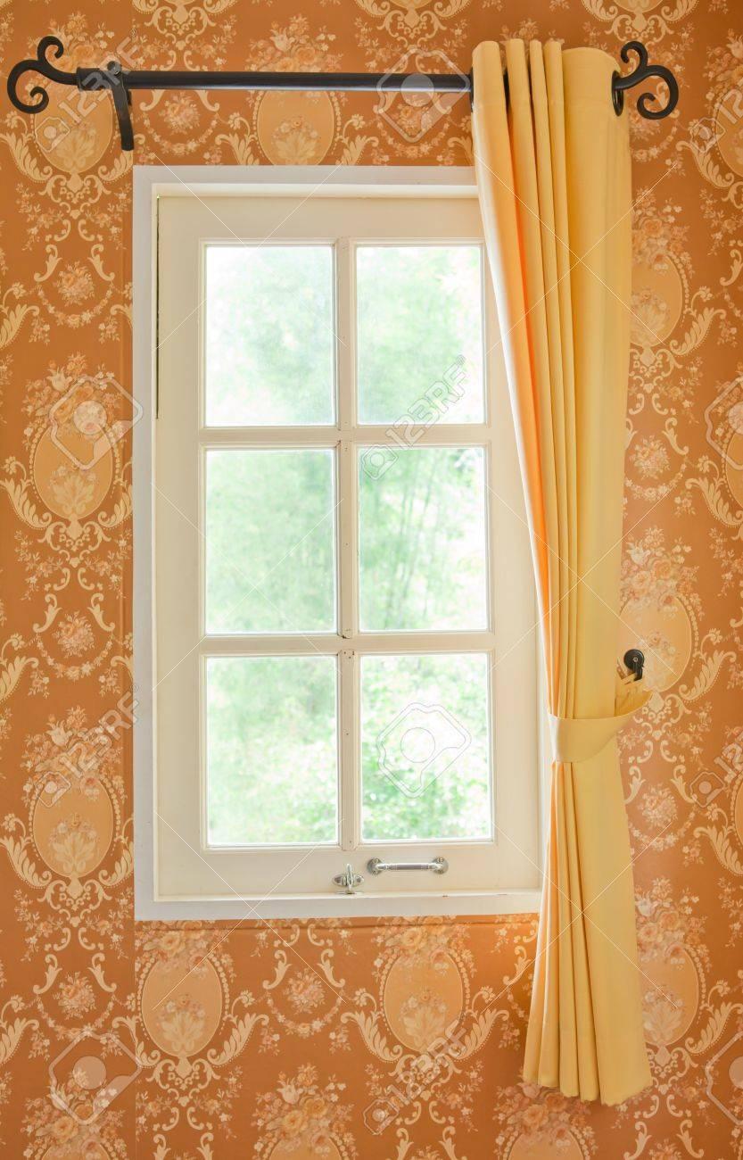 beautiful curtain on edge of a white window - 16233423