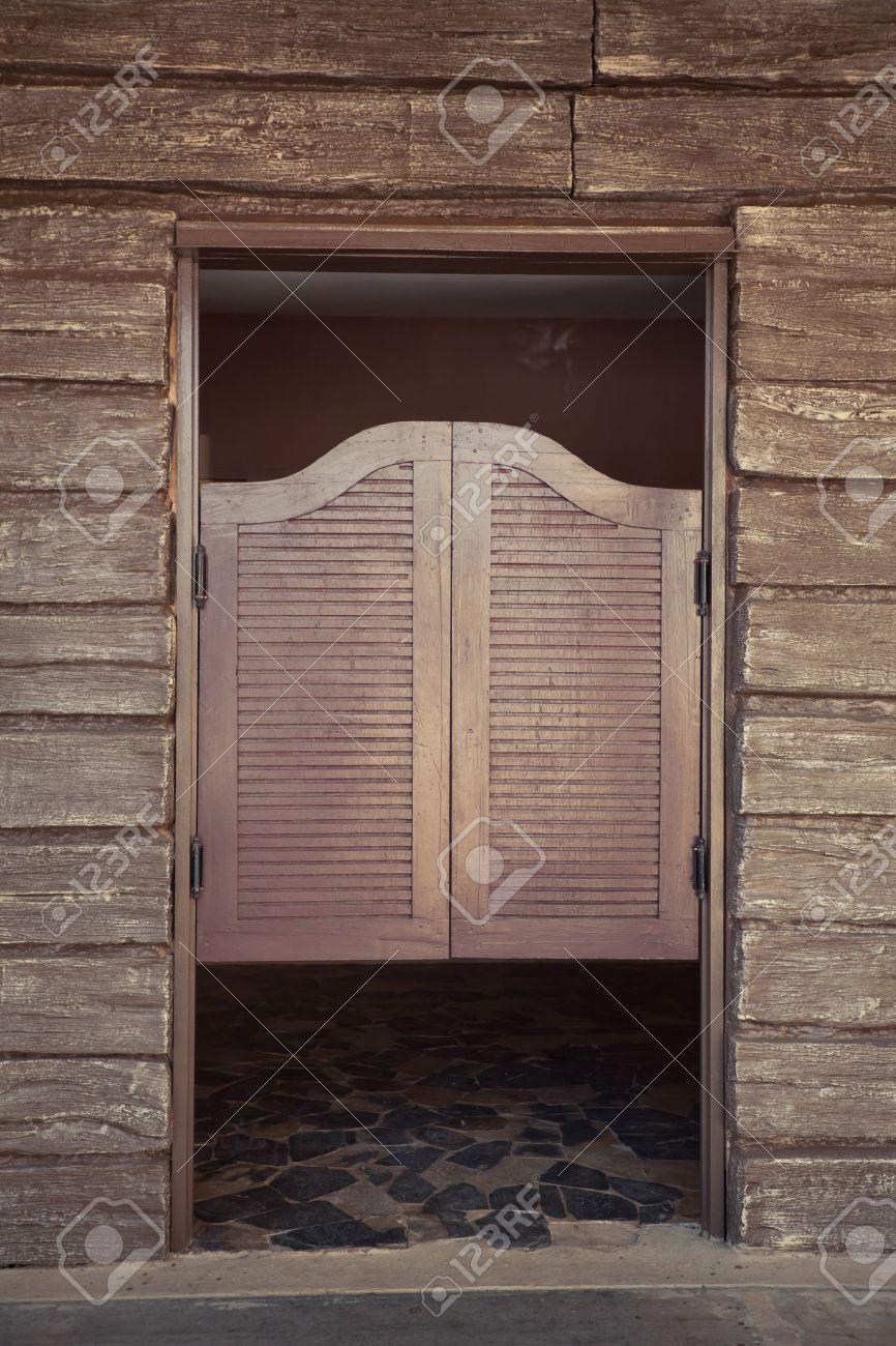 old wood doors of old western building - 16849289