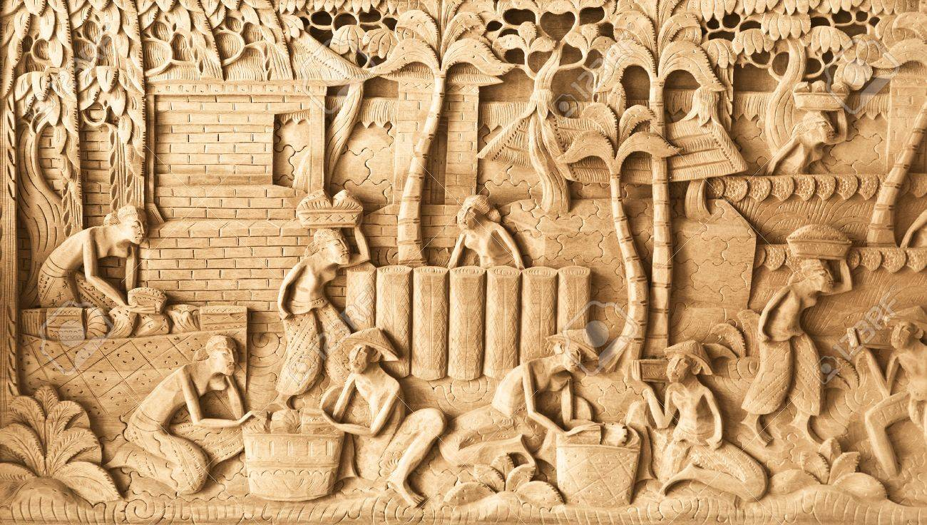 Pattern Of People Carved On Wood In Bali, Indonesia Stock Photo ...