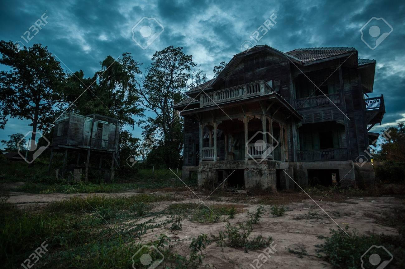 abandoned wood old house on twilight - 31708704