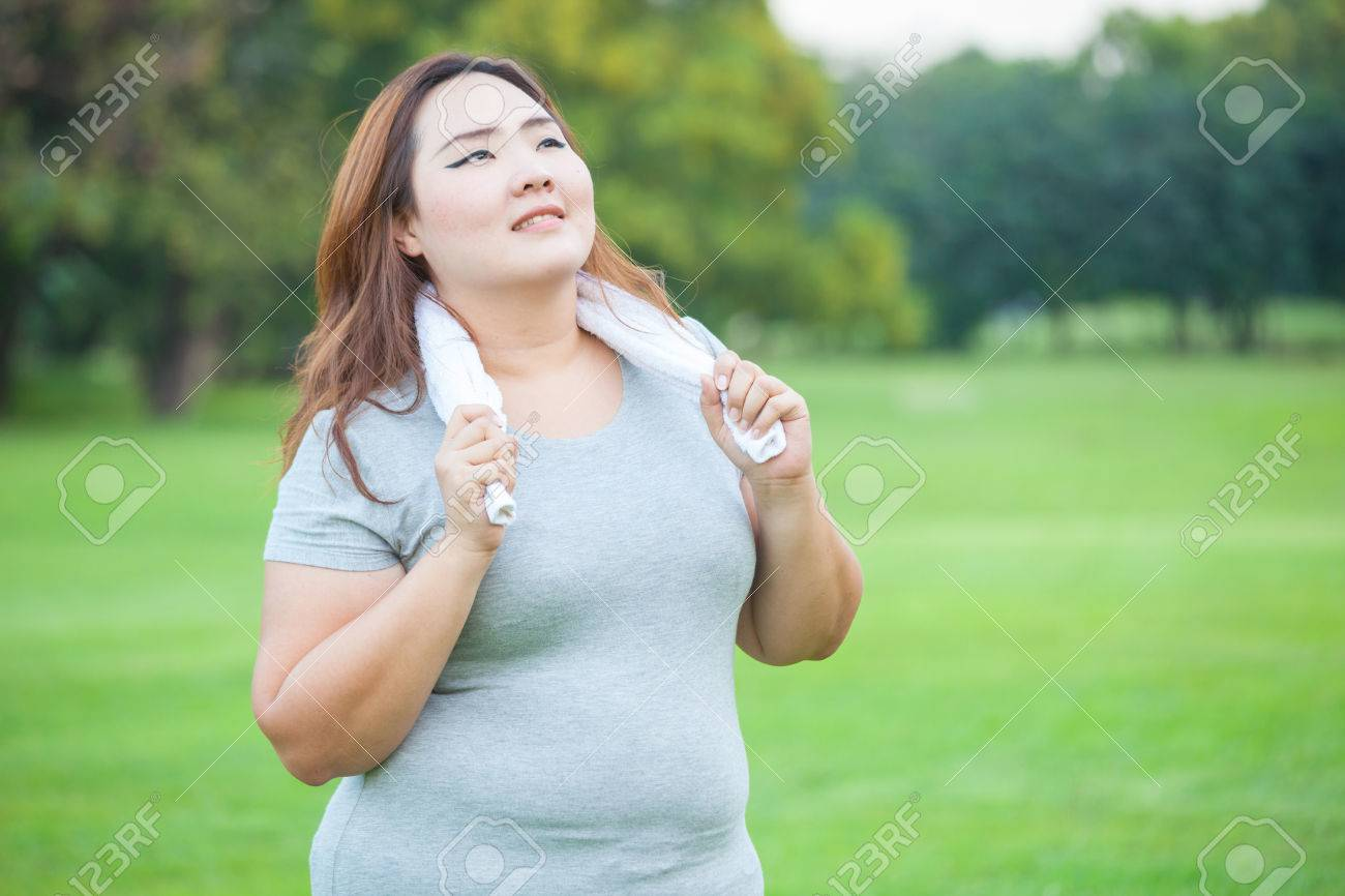Happy fatty asian fit woman posing outdoor in a park - 36575431
