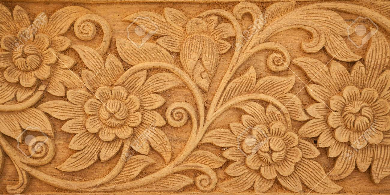 Pattern of flower carved on wood background - 40080768