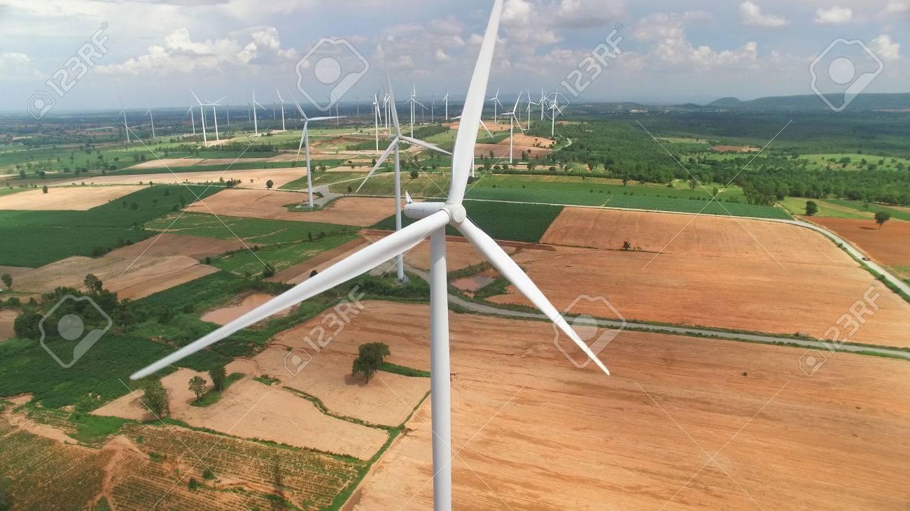 Aerial view of wind turbines in blue sky - 64673485