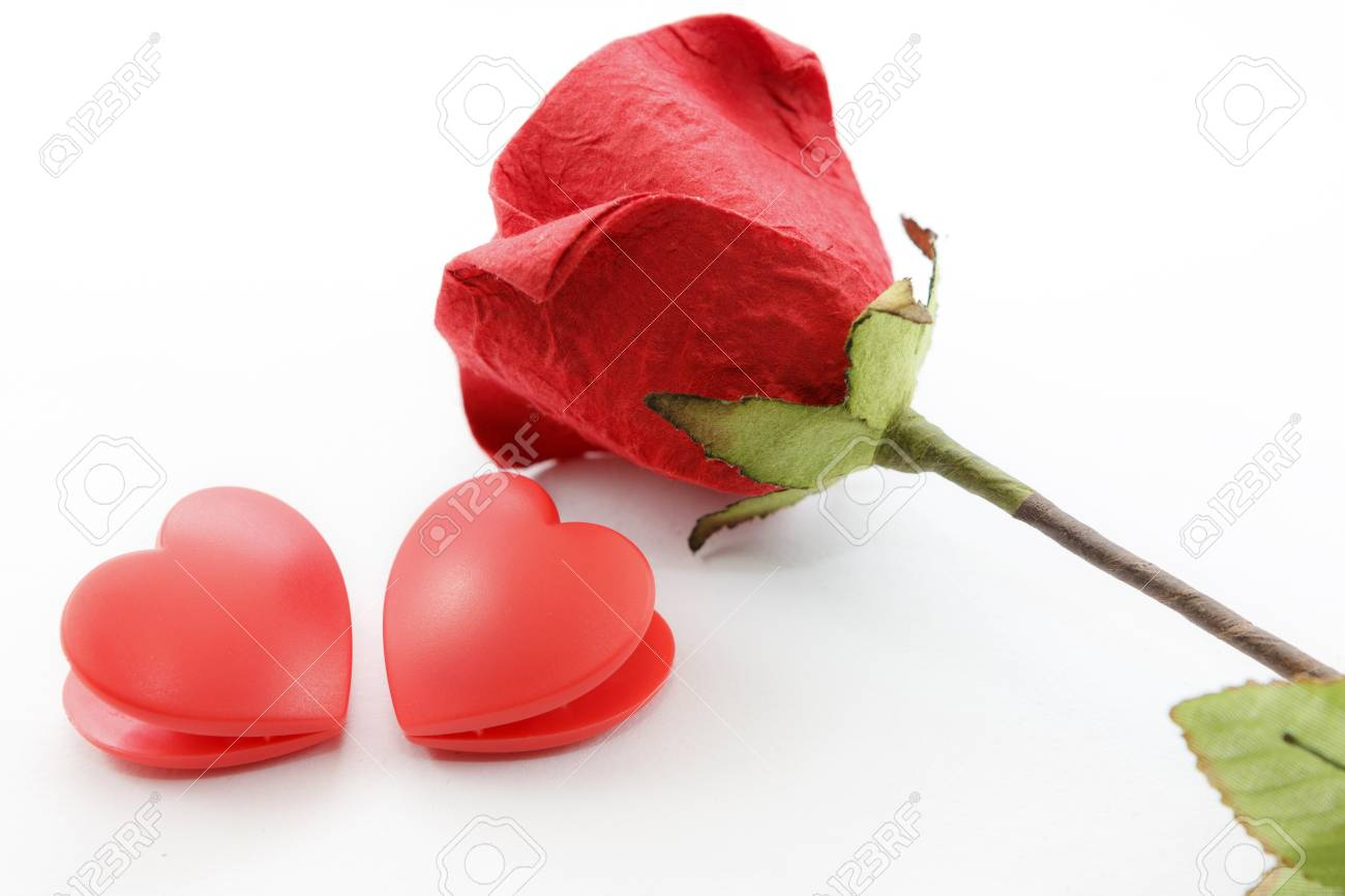 Paper rose and two heart on white background Stock Photo - 17451463