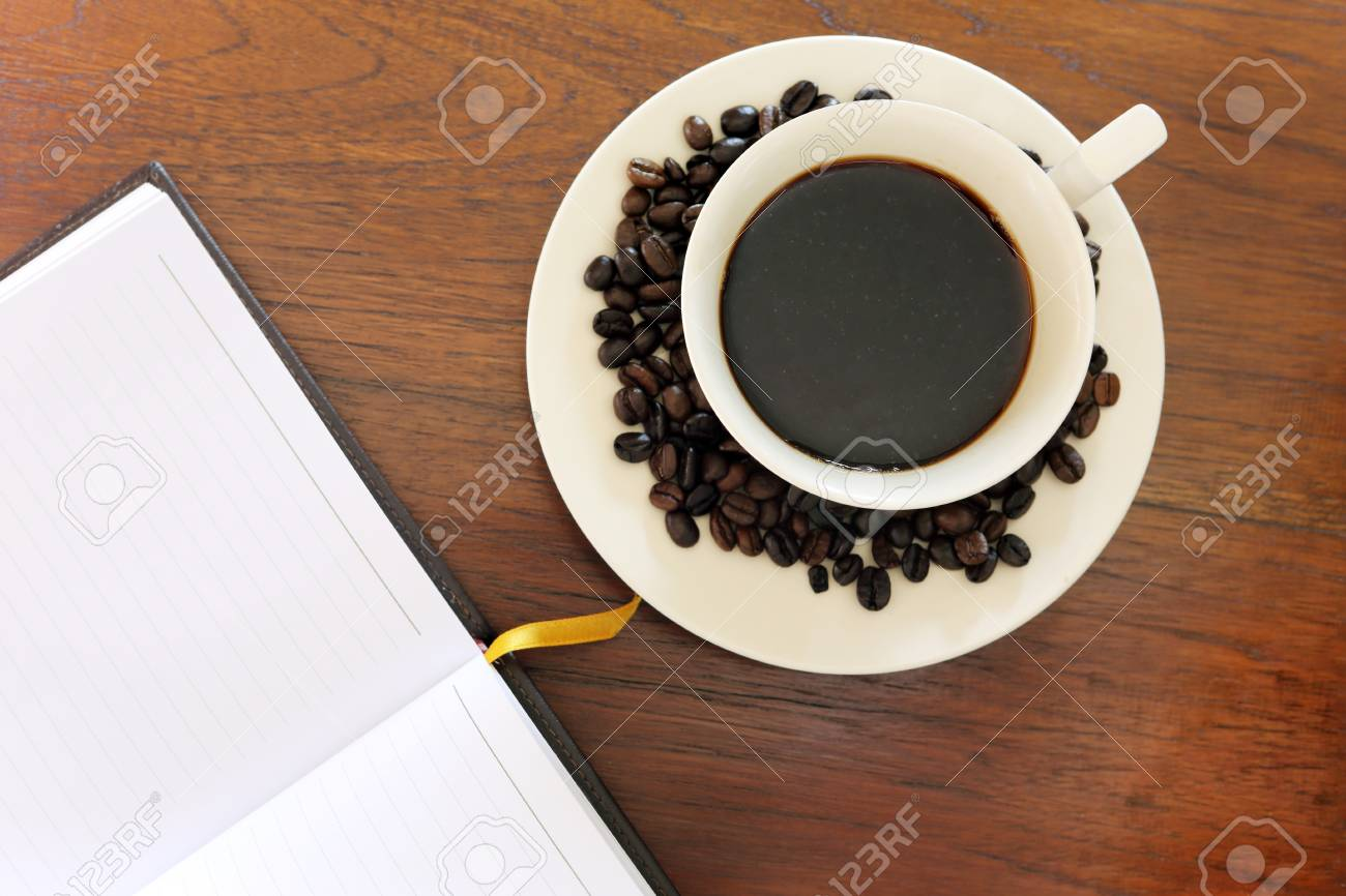 note book with coffee cup on grunge wood Stock Photo - 18139473