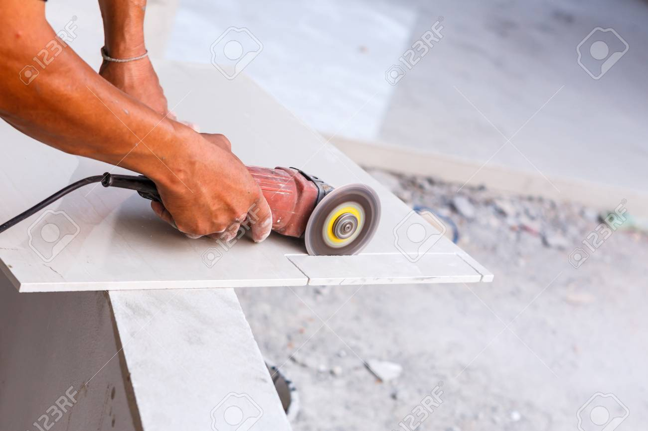 Labor cutting tile floor for new house building stock photo labor cutting tile floor for new house building stock photo 35982889 dailygadgetfo Images