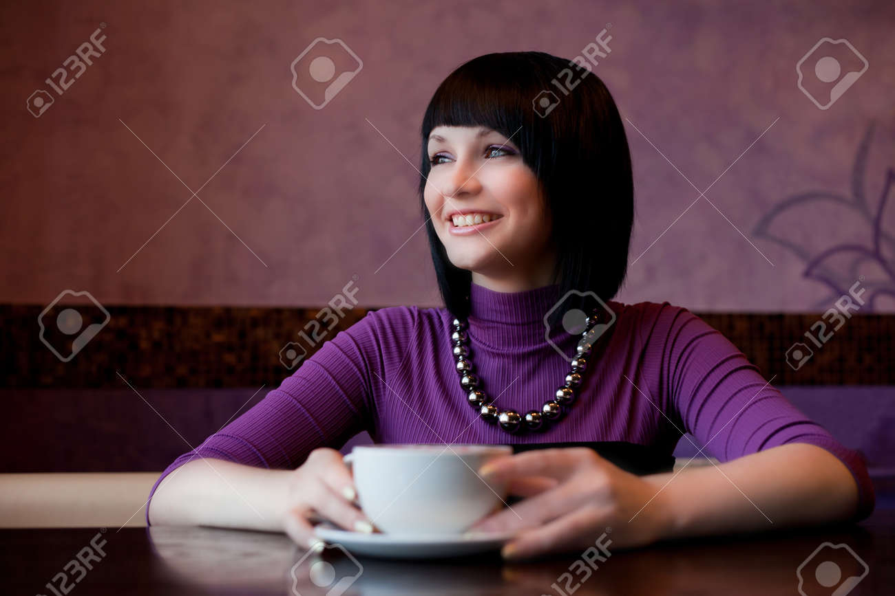 girl hold cup of coffee in hand and laugh Stock Photo - 9743008