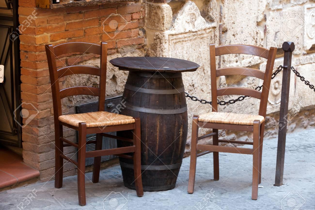 Tuscany - tables on the street Stock Photo - 15361071