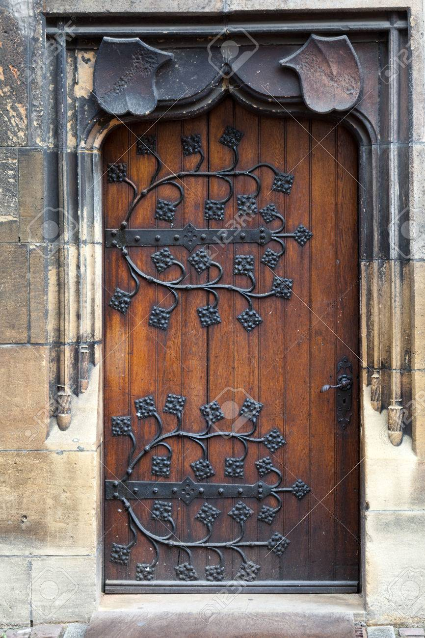 old wooden door with decorative forged metal hinges Stock Photo - 24000358 & Old Wooden Door With Decorative Forged Metal Hinges Stock Photo ...